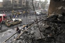 A file photo of Iraqi security forces and civilians at the site after a car bomb hit two shopping malls in Karradah in Baghdad. Photo: AP