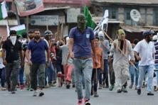 Protesters march at Lal Chowk in Srinagar on Tuesday. Photo: AFP