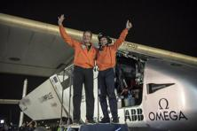 Solar Impulse pilots Bertrand Piccard, right, and Andre Borschberg celebrate the landing of their plane at an airport in Abu Dhabi, United Arab Emirates, early on Tuesday. Photo: AP