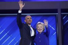 US President Barack Obama and Democratic presidential nominee Hillary Clinton appear onstage together after his speech at the Democratic National Convention in Philadelphia, on 27 July. Photo: Reuters