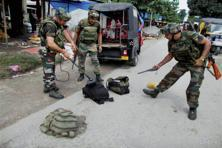 Security forces scrutinizing the bags with metal detector recovered from the NDFB (S) terrorists who launched open indiscriminate firing in the market area at Balajan Tinali near Kokrajhar town on Friday. Photo: PTI