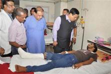 Assam chief minister Sarbananda Sonowal visits Gauhati Medical College, where injured in terrorist attack at Balajan Tiniali market are admitted, in Kokrajhar on Saturday. Photo: PTI