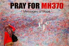 A file photo of a woman leaving a message of support and hope for the passengers of the missing Malaysia Airlines MH370 in Kuala Lumpur. Photo: Reuters