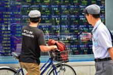 Hong Kong shares was the top gainer in Asia with a 1% rise, while a stronger yen, thanks to the Fed's cautious outlook, pulled Japan's Nikkei back 0.5%. Photo: AFP