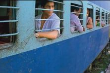 A boy sells a glass of water to SRK's Mohan Bhargava in Swades.