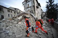 Rescuers search a crumbled building in Arcuata del Tronto, central Italy, where an earthquake struck on Wednesday. Photo: AP