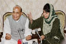 Union home minister Rajnath Singh and Jammu and Kashmir chief minister Mehbooba Mufti interact with media during a press conference in Srinagar on Thursday. Photo: PTI