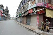 Shops, business establishments, private offices and petrol pumps have been shut as separatists groups have called for a complete strike. Photo: PTI
