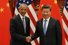 US President Barack Obama (left) and Chinese President Xi Jinping shake hands during their meeting in Hangzhou on 3 September. Photo: AFP