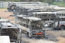 Charred remains of the buses of a private transport operator from Tamil Nadu in Bengaluru on Tuesday, a day after they were torched by pro-Kannada activists during their violent protests over Cauvery water row. Photo: Hemant Mishra/Mint