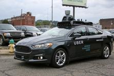 A self driving Uber car drives down River Road on Pittsburgh's Northside. A fleet of self-driving Ford Fusions began picking up Uber riders who opted to participate in a test programme. Photo: AP