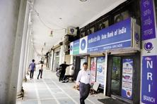 SBI's deposit rate cut will push other PSU banks to cut rates. Photo: Mint