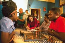 Mira Nair (centre) on the sets of Disney's 'Queen Of Katwe' with David Oyelowo (right), Madina Nalwanga (left) and Esther Lutaaya. Photo:  Edward Echwalu