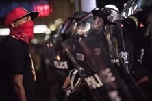 A demonstrator confronts police officers in riot gear on Thursday in downtown Charlotte, North Carolina. Photo: AFP