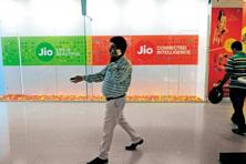 A man walks past posters of Reliance Jio Infocomm Ltd. Photo: Indranil Bhoumik/Mint