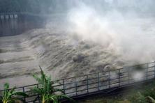 Churning waters in the Jhihtan dam is seen in Xindian district, New Taipei City, as Typhoon Megi hit eastern Taiwan on Tuesday. Photo: Sam Yeh/AFP