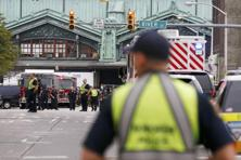 Police officers look over the scene of a train crash where a New Jersey Transit train derailed and crashed through the station in Hoboken, New Jersey, on Thursday. Photo: Reuters