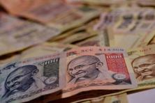 The rupee is down 0.67% till date this year, while foreign institutional investors have bought $7.54 billion in equity and $253.90 million in debt markets . Photo: Pradeep Gaur/Mint