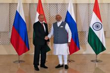 Russian President Vladimir Putin shakes hand with PM Narendra Modi ahead of the India-Russia annual summit in Goa on Saturday. Photo: Reuters