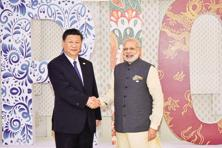 Prime Minister Narendra Modi with Chinese President Xi Jinping at the eighth BRICS summit in Goa on Sunday. Photo: AFP