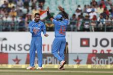 Hardik Pandya (left) and Rohit Sharma celebrate the dismissal of New Zealand's Luke Ronchi during their first one-day international cricket match in Dharmsala on 16 October 2016. Photo: AP