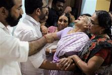 Slain BJP activist Ramith's relatives crying at their residence at Pinarayi in Kannur on October 13. Photo: PTI