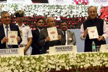 (From left) Chief justice T.S. Thakur, President Pranab Mukherjee and finance minister Arun Jaitley during the inauguration of 'Global Conference on National Initiative towards Strengthening Arbitration and Enforcement in India' in New Delhi on Friday. Photo: PTI