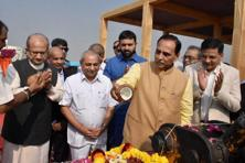Gujarat CM Vijay Rupani and Dy CM Nitinbhai Patel at foundation stone laying ceremony for Surat Diamond Bourse at Khajod in Surat on Sunday. Photo: PTI