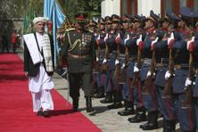 A file photo of Afghan President Ashraf Ghani inspecting an honour guard at the presidential palace in Kabul, Afghanistan. Photo: AP
