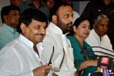 UP Samajwadi Party president Shivpal Singh Yadav (left) addresses a press conference after chief minister Akhilesh Yadav sacked him from his cabinet at the party office in Lucknow on Sunday. Photo: PTI
