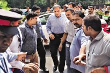 Tata Sons interim chairman Ratan Tata (centre) arrives at his office after attending a company meeting at Bombay House, in Mumbai on Tuesday. Photo: Reuters