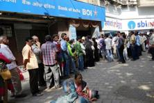 Huge rush and long queues were witnessed at banks on Thursday after a day's break, as people jostled to get lower value currency to meet their daily basic needs. Photo: AP
