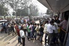 People queue up at an ATM in Patna. Photo: PTI