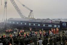 Rescuers work in progress at the site of accident where Patna-Indore Express train derailed near Pukhrayan village near Kanpur. Photo: PTI