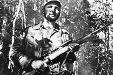 In this 26 February 1957 file photo, Cuba's leader Fidel Castro stands in an unknown location in Cuba. AP
