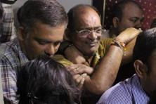 Police and income tax officials detain Mahesh Shah (centre), who declared Rs13,860 crore under IDS, in Ahmedabad on Saturday. Photo: PTI