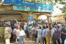 People desperate for cash are still queuing up at bank branches and ATMs for withdrawals on which strict limits have been placed.  Photo: Indranil Bhoumik/Mint