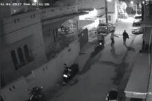 Still image, taken from 1 January 2017 CCTV footage, shows two men on a scooter assaulting a woman in Bengaluru on the eve of New Year celebrations. Photo: Reuters