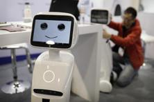 Robots and other types of automation are a threat to that development model. Photo: AP