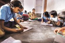 The HRD ministry is considering making allocations for education schemes such as Sarva Siksha Abhiyan and mid-day meals performance-based. Photo: Mint