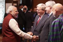 PM Narendra Modi with former PM of Australia Kevin Rudd, former PM of Canada Stephen Harper and former Afghanistan president Hamid Karzai in New Delhi on Tuesday. Photo: PTI