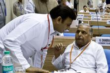 The power struggle intensified in the Samajwadi Party with the warring father, Mulayam Singh Yadav (right), and son, Akhilesh, expelling members from the rival camp. Photo: AFP