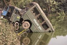 Two police vans seen lying in a pond after Tuesday's violent protests at Bhangar, near Kolkata. Photo: Indranil Bhoumik/Mint