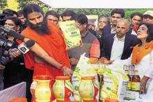 This month, Baba Ramdev's Patanjali Ayurved won a two-notch credit rating upgrade from ICRA. Photo: HT