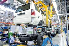A file photo of an Indian worker at a production line of vehicles General Motors India plant at Halol, 160 km from Ahmedabad. GM said in July 2015 it wanted to shut the Halol factory and spend $1 billion in expanding its Talegaon factory in Maharashtra. Last year, it said the Halol factory would function until March 2017. Photo: AFP