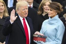 Donald Trump is sworn in as the 45th president of the United States as Melania Trump looks on during the 58th Presidential Inauguration at the US Capitol in Washington. Photo: AP
