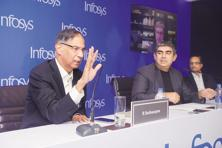 Infosys chairman R. Seshasayee (left) and CEO Vishal Sikka in Mumbai on Monday. The Infosys founders, led by Narayana Murthy, had complained of corporate governance issues at the firm. Photo: Abhijit Bhatlekar/Mint
