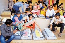Preparations on at a polling booth in Thane on Monday. Photo: PTI
