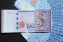 Indonesia's rupiah has strengthened 26% against the Malaysian ringgit since June 2014, the biggest rally so far in the new century. Photo: Bloomberg