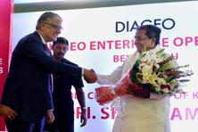 Karnataka CM Siddaramaiah with Diageo chief executive Ivan Menezes during the inauguration of the Diageo Enterprise Operations in Bengaluru on Tuesday. Photo: PTI